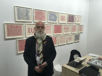 AA Bronson captured in Caroline Nitsch's booth at Art Basel in front of works by Louise Bourgeois, Art Basel, 2016. © FAM Editorial