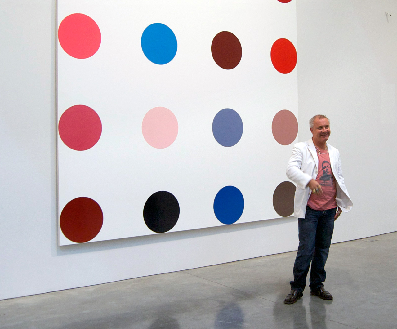 "Damien Hirst at the exhibition ""Damien Hirst The Complete Spot Paintings 1986-2011"", Gagosian Gallery, New York. Image: Andrew Russeth, New York. Source: Wikimedia Commons"