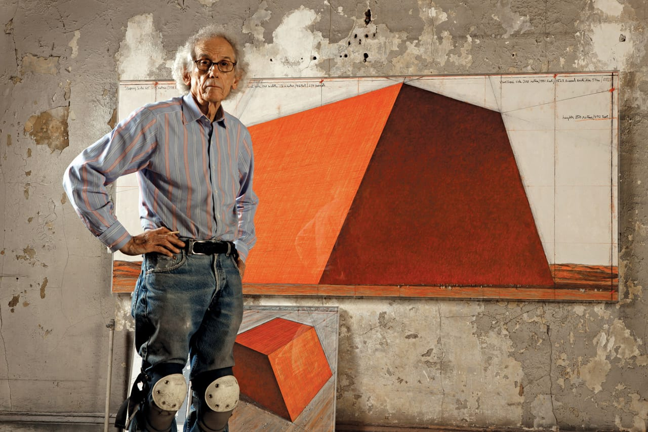 Christo in his studio with a preparatory drawing for The Mastaba, 2012. Photo: Wolfgang Volz. © 2012 Christo