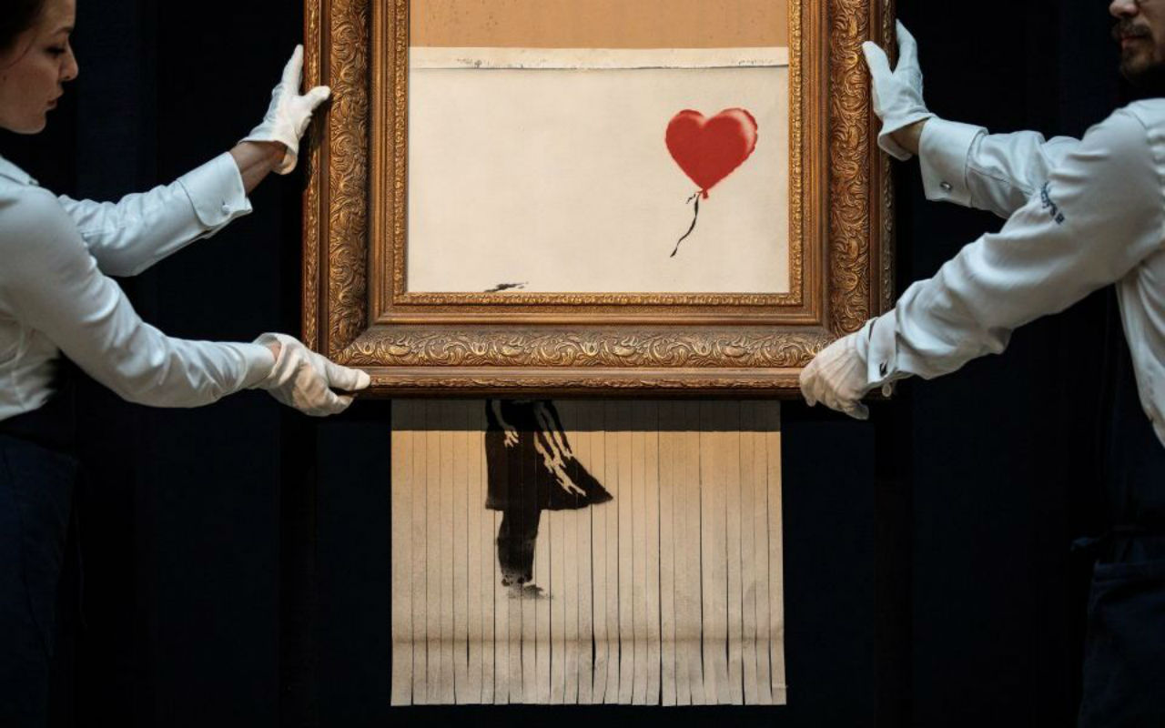 Banksy's Shredded Girl with Balloon at Sotheby's London, 2018. Image: via City A.M.