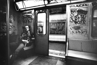 Tseng Kwong Chi, Keith Haring in subway car, circa 1983. Photo © Muna Tseng Dance Projects, Inc. Art © Keith Haring Foundation