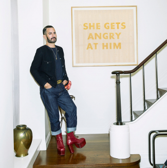 Marc Jacobs in his apartment in front of an Ed Ruscha She Gets Angry At Him. Image: Courtesy of Sotheby's