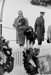 A Father and Son Give a Salute at the Grave of J.F. Kennedy, Washington