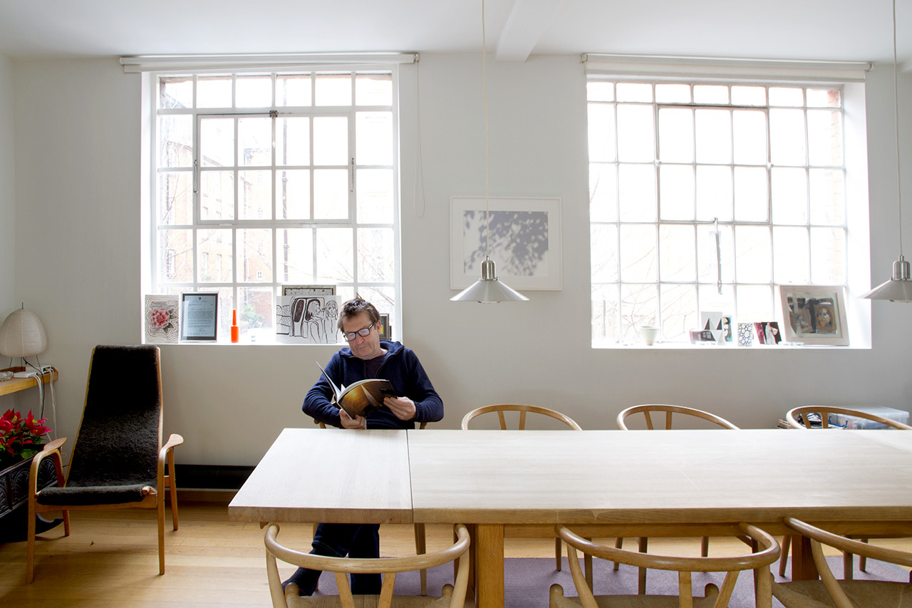 Brad Lochore at his kitchen table in his home—a converted printing factory in Shoreditch