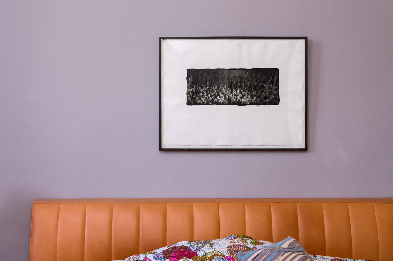 A Linda McCartney photograph above sofa