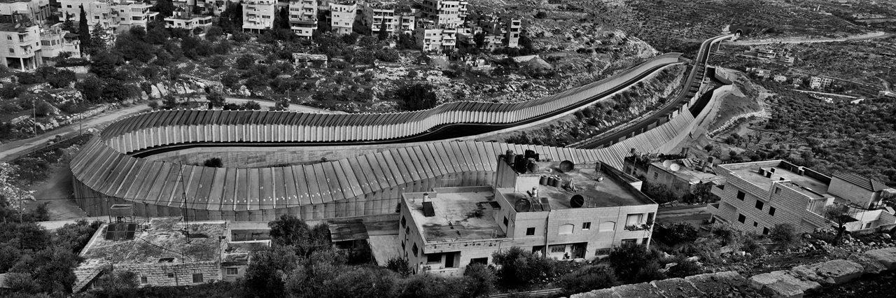 "Josef Koudelka, Route 60, Beit Jala, Bethlehem area. Specially designed concrete slabs were incorporated into the Wall along major transport routes such as Road 60 to prevent potential attacks. Exhibition ""This Place"" Image: © Josef Koudelka / Magnum Photo"