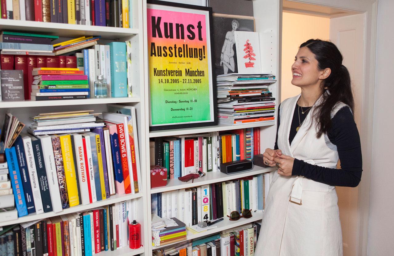 Esra Aydin beside Jeremy Deller's Kunstverein München exhibition poster. Image: © Juliane Spaete