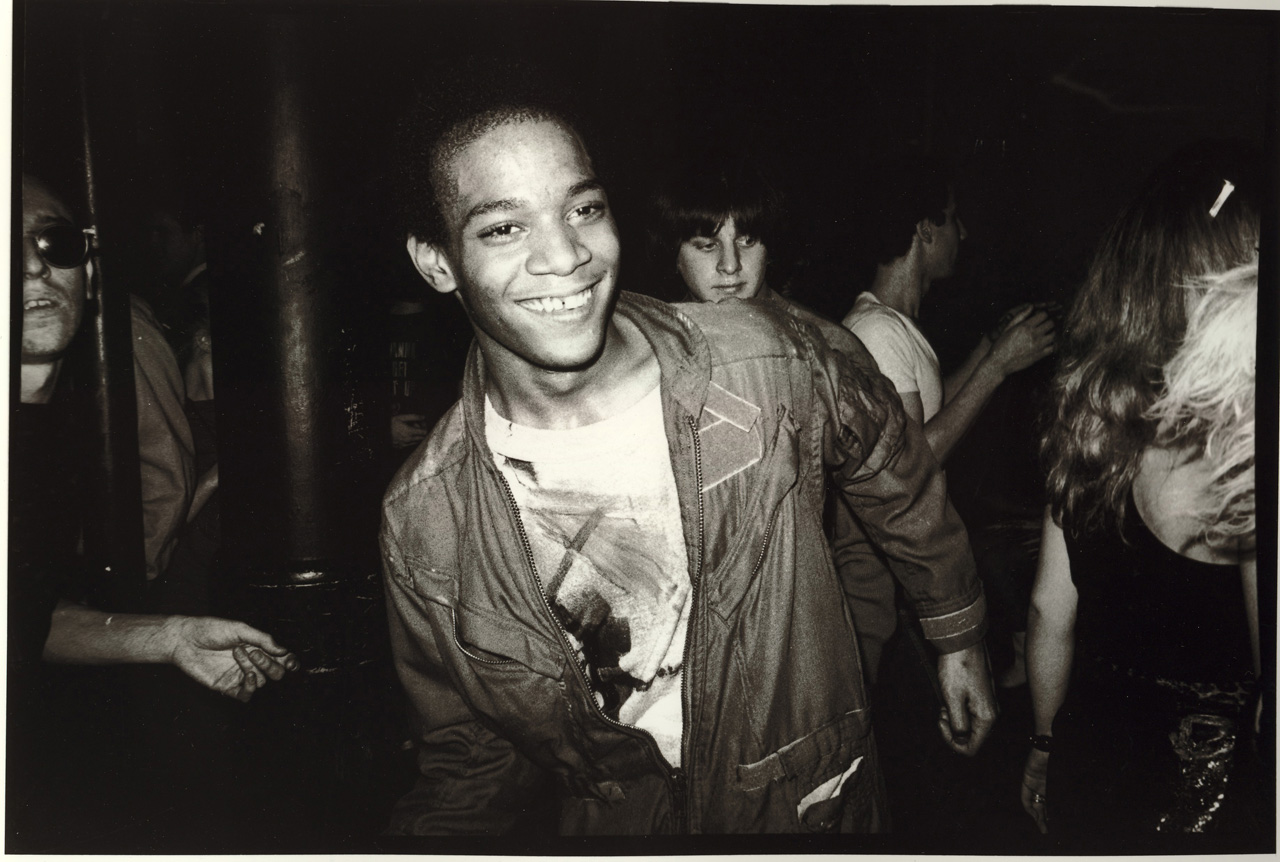 A photo of Jean-Michel Basquiat dancing at the Mudd Club