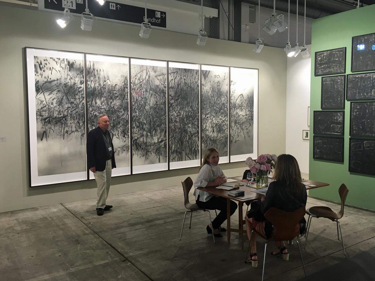 Niels Borch Jensen standing in front of Julie Mehretu's vast work Damascus