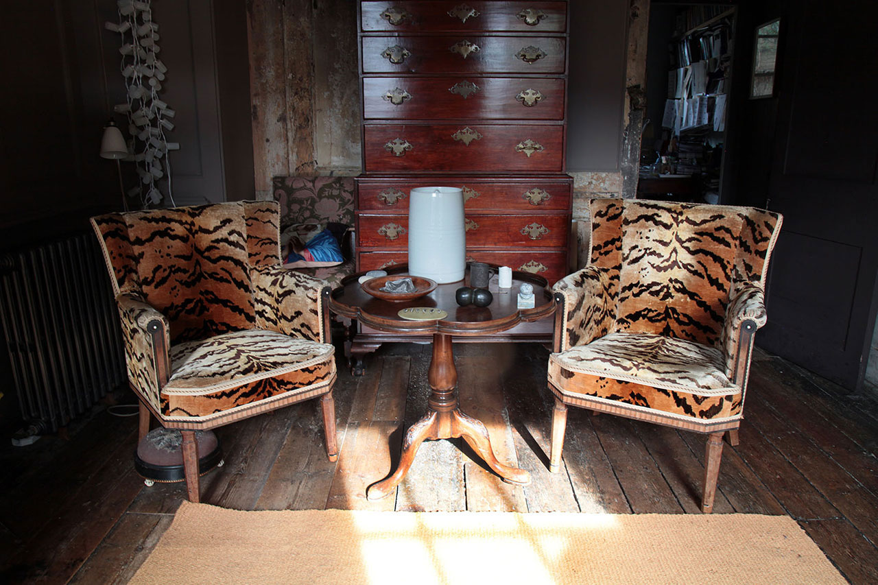 Two tigerskin chairs by designed by Arthur Livingston Savage (Romilly's grandfather)