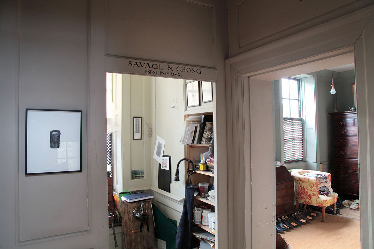 View of the upstairs jewellery workshop and the pigeon bedroom, with print by Charlotte Verity