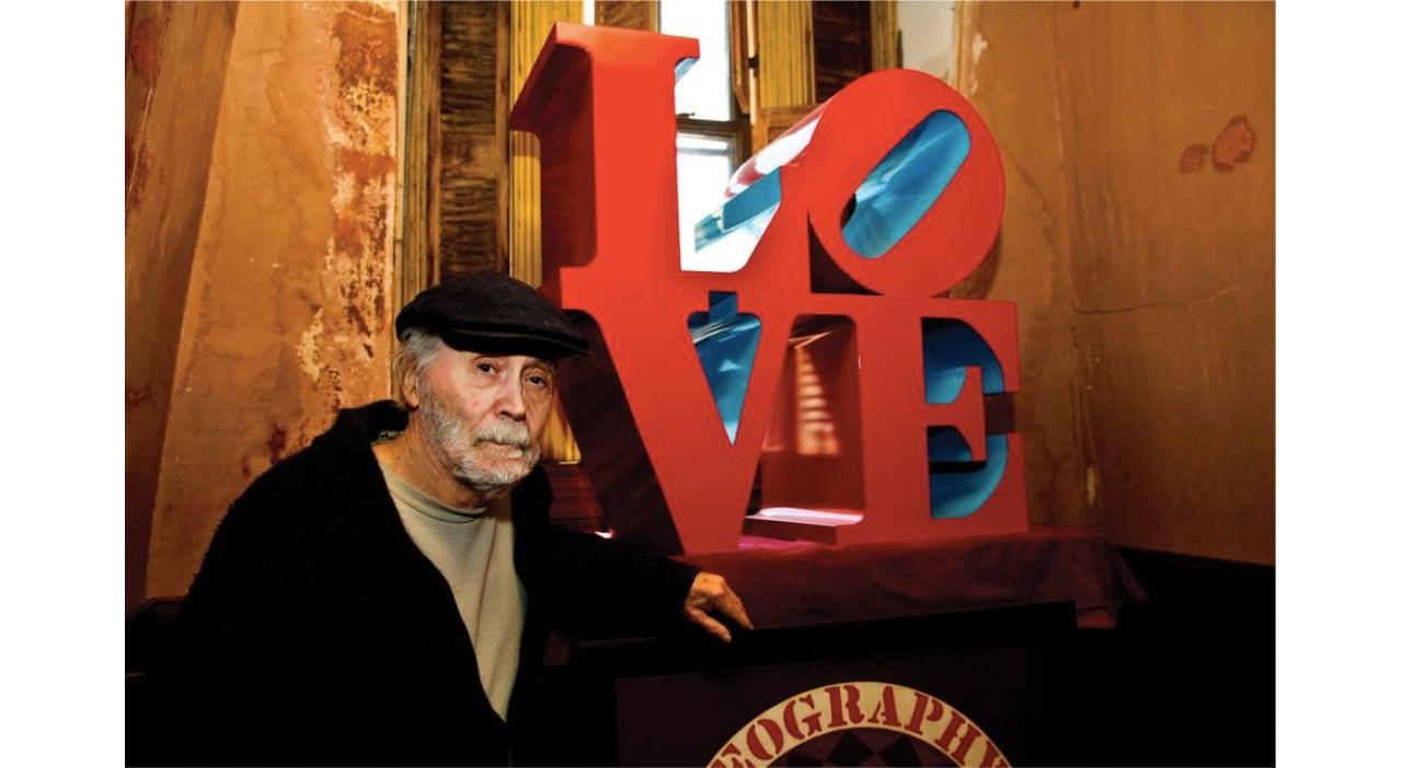 Robert Indiana in front of his artwork, LOVE. Image: © Joel Greenberg